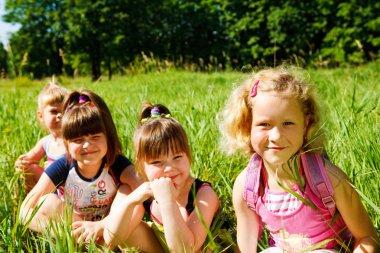 Schoolgirls in grass