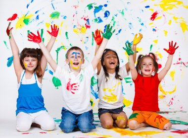 A group of cheerful kids with their palms and clothing painted stock vector