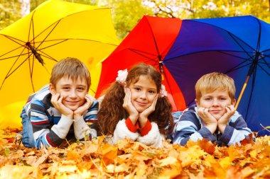 Children under umbrellas