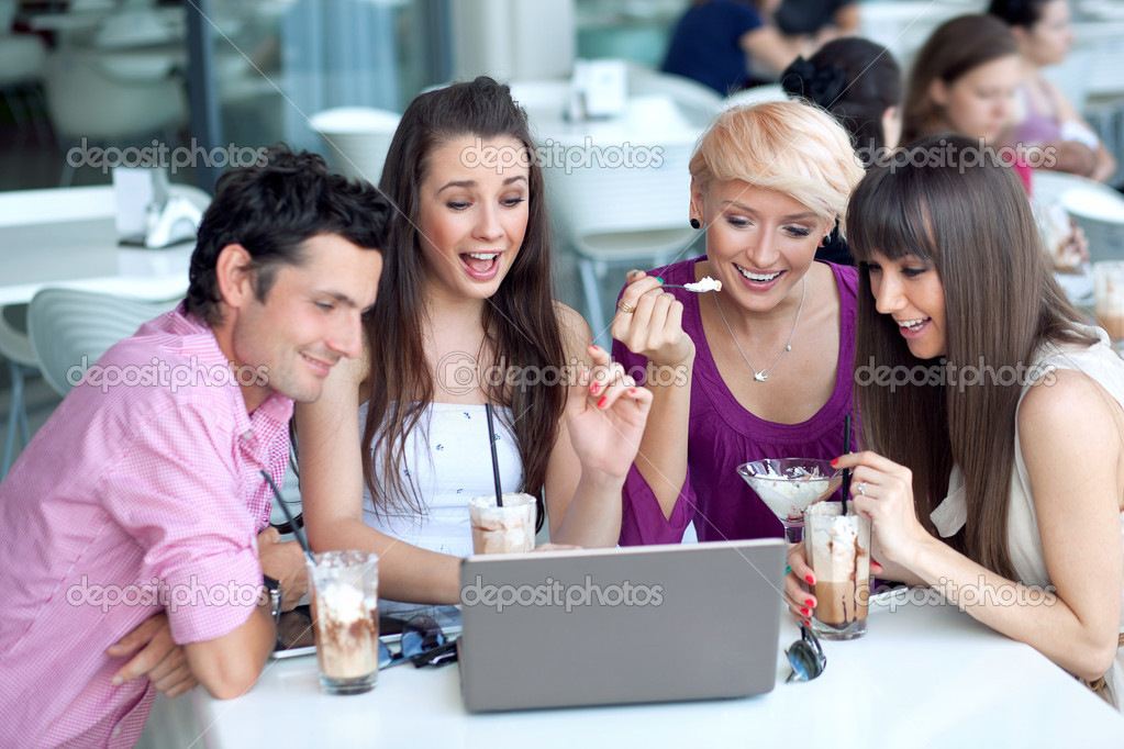 Young browsing internet in a restaurant