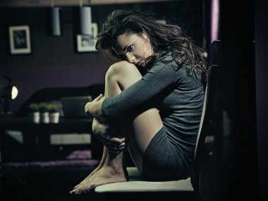 Sad woman sitting on a chair
