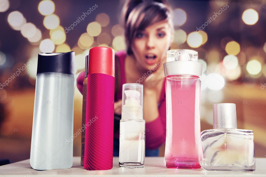 Surprised woman looking at perfumes