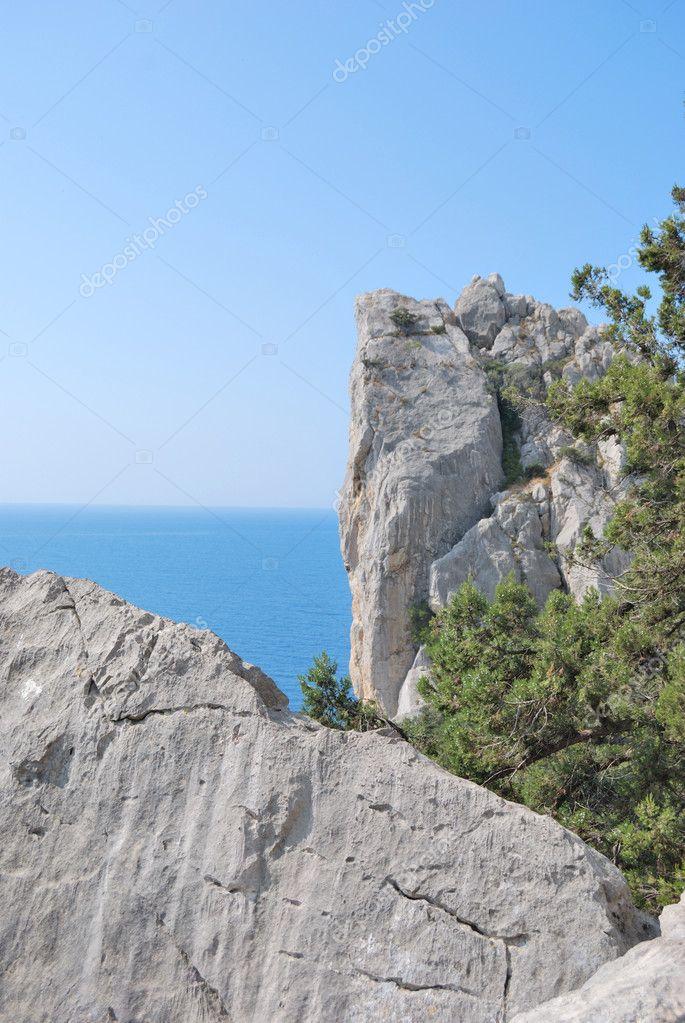 Rock on backgroun sea