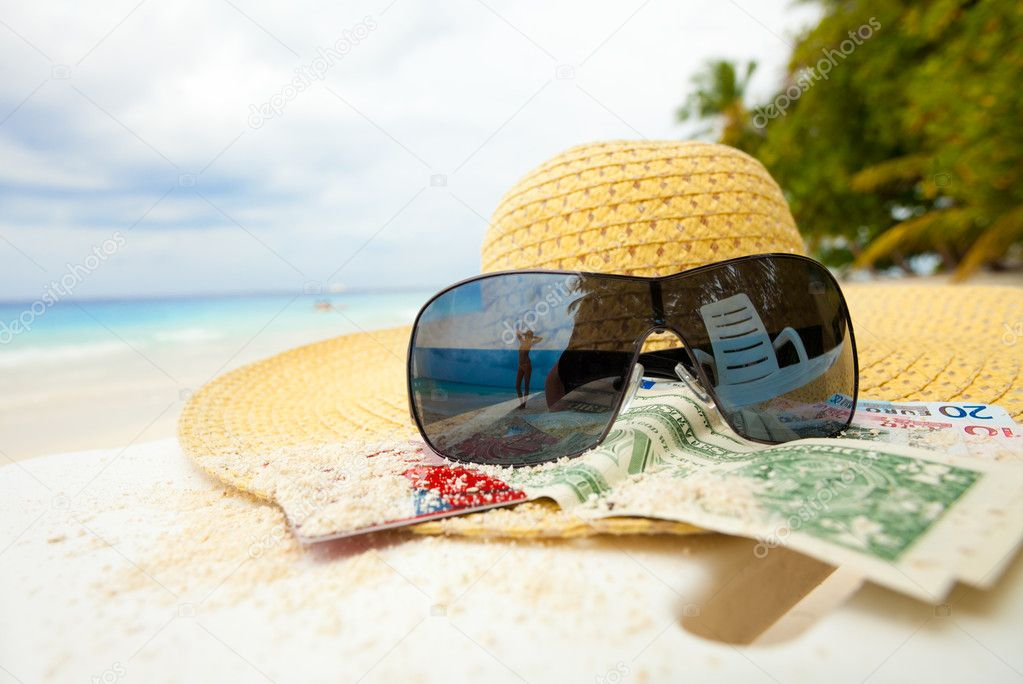 Straw hat, shades and money - all you need to relax on the beach