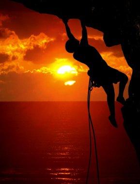 Rock climbing during sunset