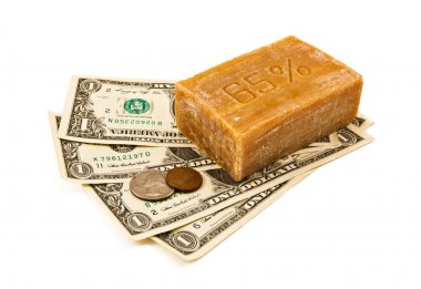 Laundering of money. Money and soap on the white background