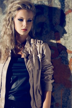 Beautiful blond woman wearing leather jacket