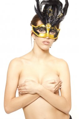 Beautiful woman portrait in yellow venetian mask on white isolated
