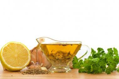 Salad dressing with olive oil, garlic and lemon
