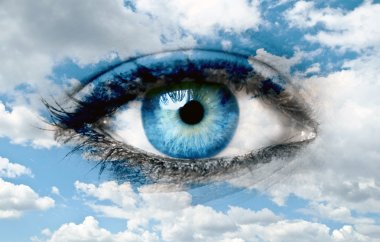 Blue eye and blue sky - Spiritual concept