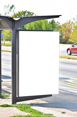 Empty white billboard at bus stop