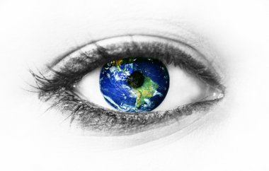 Planet earth in eye isolated on white