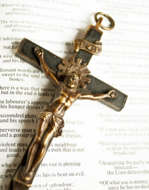 Cross with crucified Jesus Christ on open bible