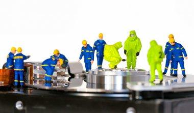 Team of technicians repair hard disk