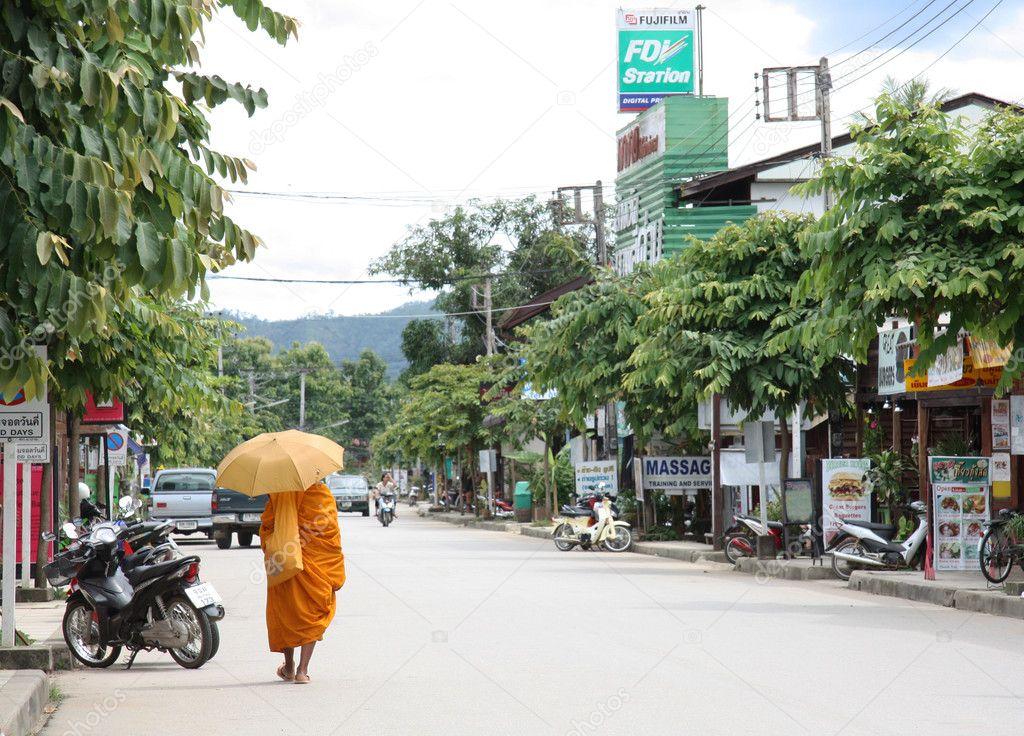 Monk walking in Pai, Thailand
