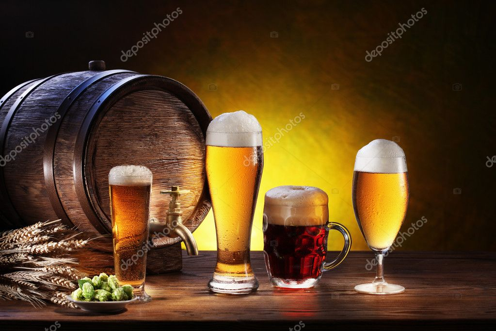 Beer barrel with beer glasses on a wooden table.