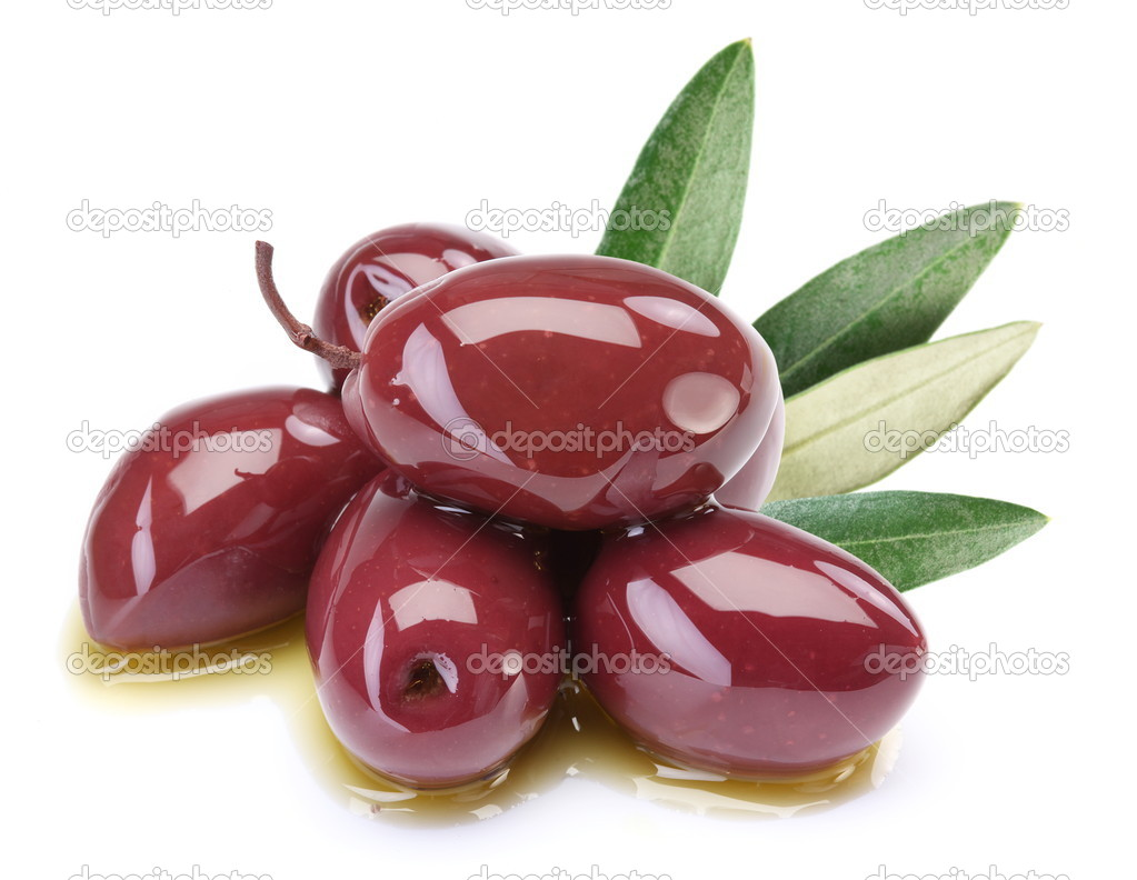 Purple olives in oil with leaves
