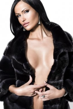 Sexual woman in underwear and in a fur coat