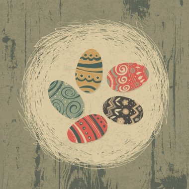Easter eggs in nest on wooden texture. Easter background, retro