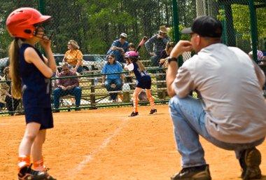 Girl's Softball Runner and Coach