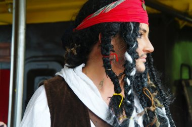 Actor in the guise of Jack Sparrow in the interior of a sailing ship
