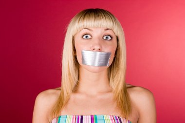 Blonde with duct tape on her lips