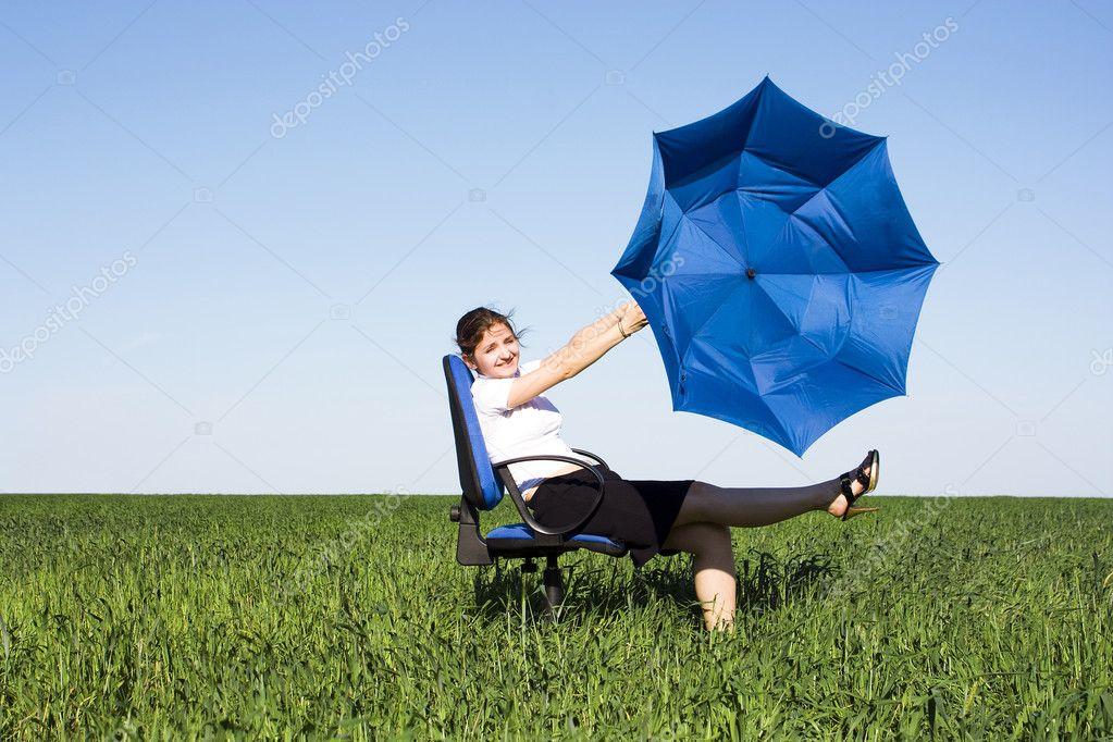 傘風の少女を運び去る — ストッ...