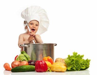 Little boy in chef's hat