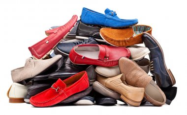 Pile of various men shoes, with clipping path