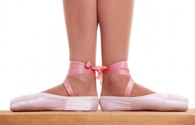 Cropped view of ballerina's feet in pointes