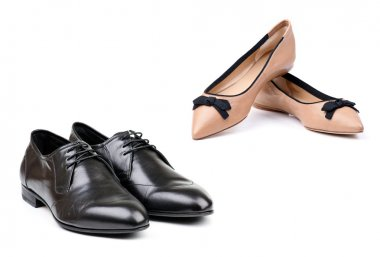 Two pairs of men and women shoes over white