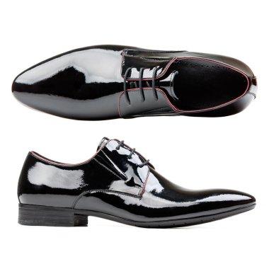Black patent leather men shoes against white