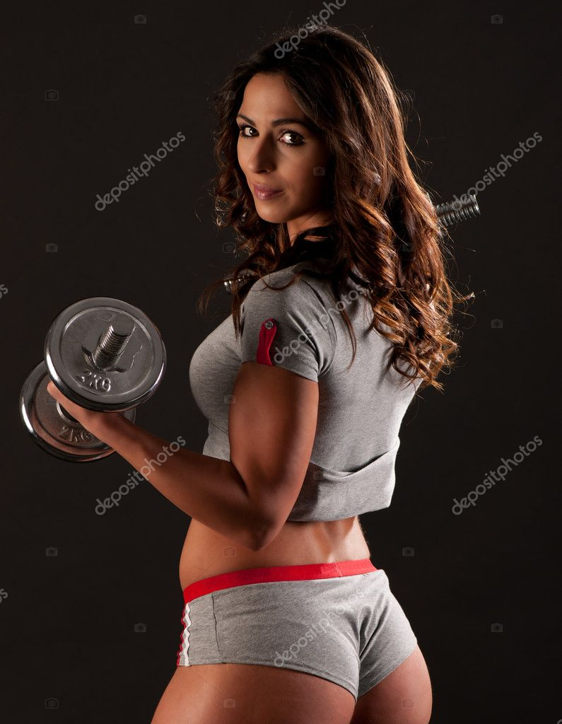Young fit girl working out with weights - Portrait of pretty you