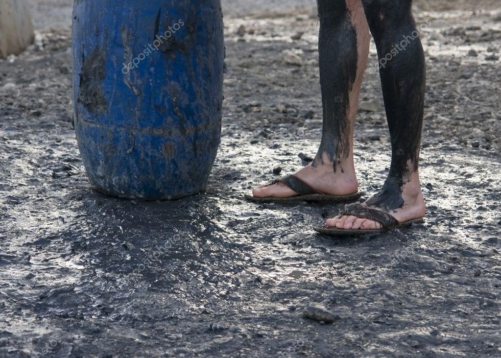 Black mud in Dead Sea beach.