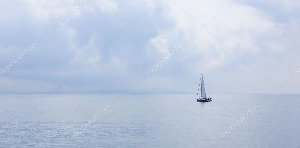 Yacht in a foggy day