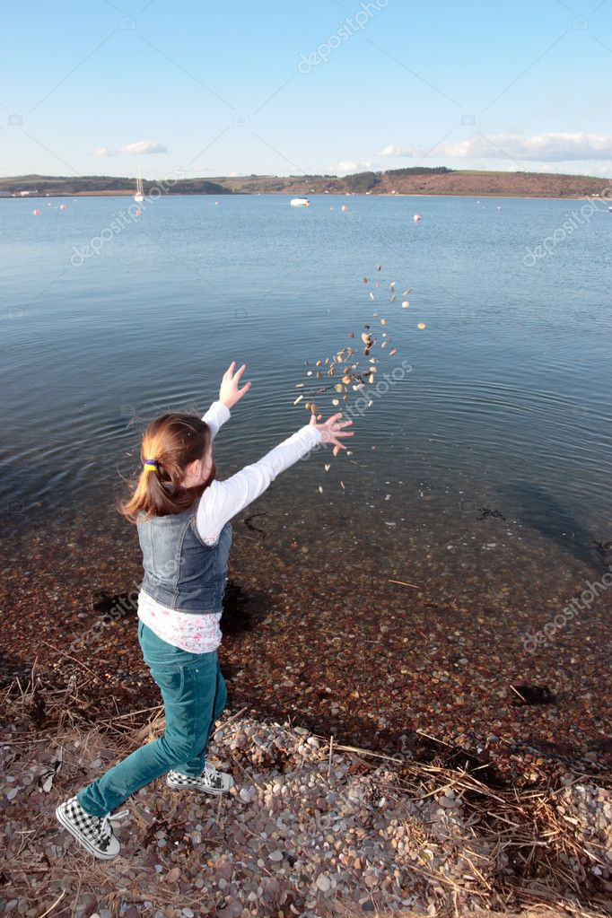 Young girl throwing stones