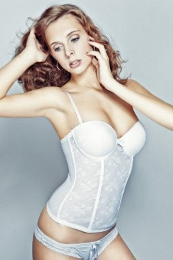 Sexy girl in white corset