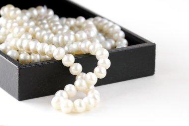 Macro pearls in black gift box