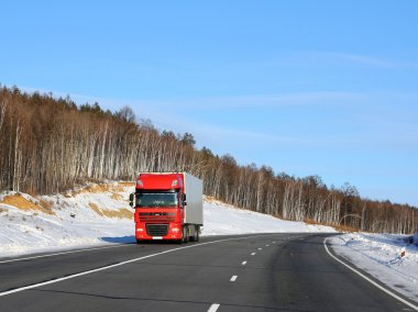 The red truck on a winter road.
