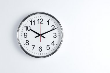 Clock hanging at the wall with copy space