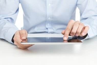 Young adult using digital tablet