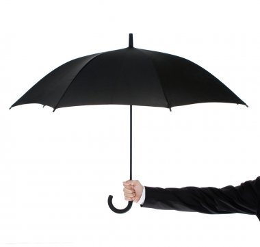 Open umbrella in human hand