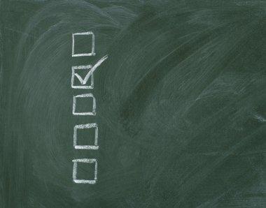 Checklist at the blackboard