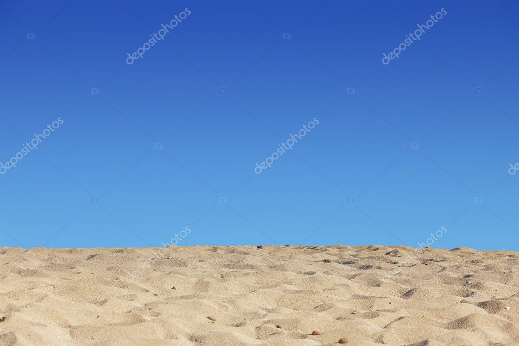 Beach blue sky and sand background
