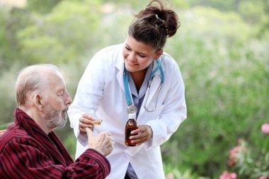 Senior man with doctor or nurse