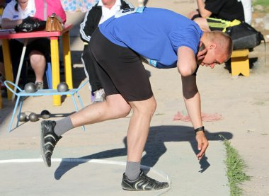 Lesnik Artem compete in the shot put competition