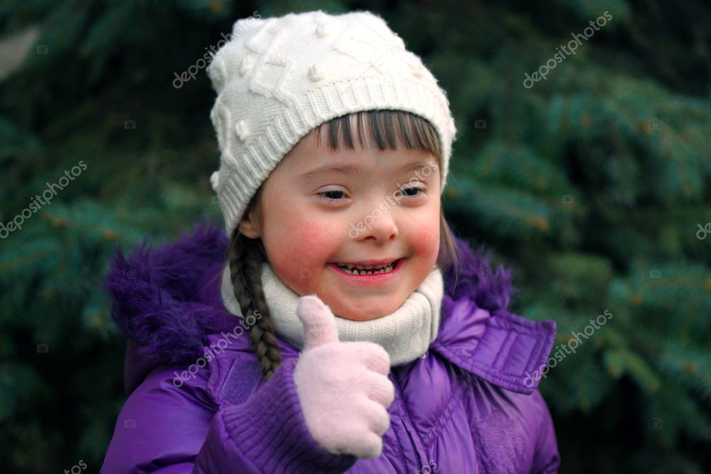 Portrait of young girl giving thumbs up
