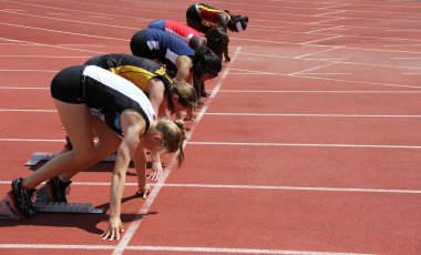 Girls on the start of the 100 meters dash