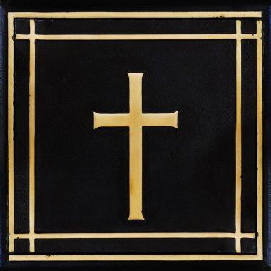 Golden cross, symbol of the Christian faith on the black backgro