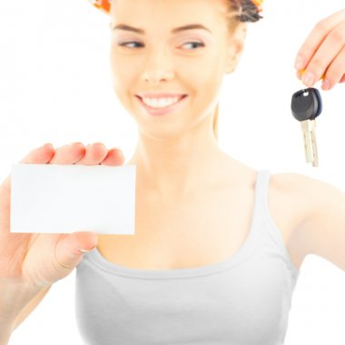 Happy woman wearing protective helmet holding new key and blank white card stock vector